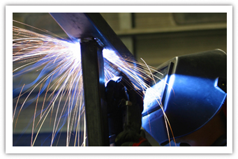 man in welder mask welding